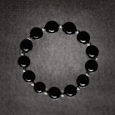 Elastic bracelet jet balls and silver made whit traditional methods. Artcraft of The Way of Saint James. Tax free $44.90