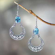 Unique Sterling Silver and Blue Topaz Dangle Earrings - Sumatra Moons | NOVICA