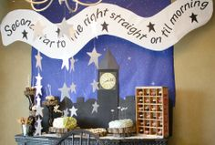 Peter Pan Party- Sky backdrop, bulletin board paper from Hobby Lobby. Banner made by hand, Clock and London skyline cut from cardboard and sprayed black