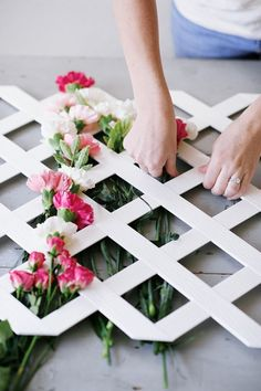 Spell out letters with flowers and lattice from the hardware store. Hang as a backdrop for a garden party!