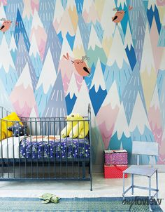 such pretty colors...mountain mural in a nursery...