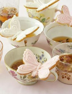 Butterfly cookies on teacup.