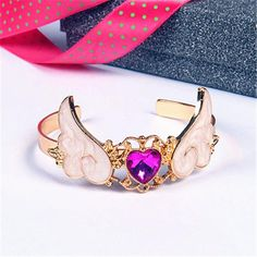 A stunning gold plated angel wing gemstone cuff bracelet. Perfect for magical girls! So kawaii! Kawaii Jewelry, Kawaii Accessories, Cute Jewelry, Jewelry Accessories, Harajuku, Magical Jewelry, Cute Charms, Sailor Moon Crystal, Barbie