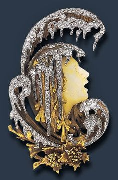 GABRIEL FALGUIERES  Designed as a carved hardstone profile of Orpheus as he floats down the river Hades, encased by a vari-cut diamond and textured gold stylized wave, enhanced by two sculpted gold floral motifs, mounted in gold, circa 1901