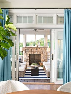 They look like French doors when closed, but these Pella doors leading to the screen porch are actually space-saving sliders with automated shades between the glass panes. Sensors on windows and doors let you know (via your phone and a lighted panel) if they're open or even unlocked.