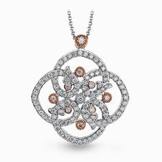 Come see the stunning floral design white gold pendant, set with .49 ctw of dazzling white diamonds, accented with delicate rose gold, and many others by Simon G at the Ben Garelick Trunk Show Friday April 24th from 10 am to 7 pm. This pendant $2640.