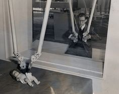 At West Berlin's Industrial Fair a US Information Service exhibit permits Berliners to try out magic hands, a device for handling radioactive materials that is so delicate that it can be used to pin a diaper on a doll, 1954