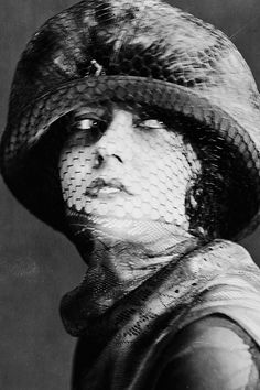 """ Original caption: circa 1925: American actress Gloria Swanson (1899 - 1983) wearing a hat with a veil covering her face.  """