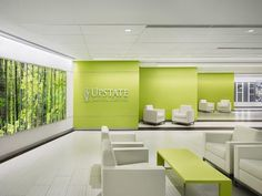 SUNY Upstate Cancer Center, designed by EwingCole, takes a bold approach to bringing nature indoors with vibrant supergraphics and cheery pops of color. Photo: courtesy of IIDA