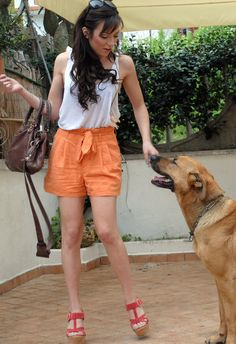 Pastel Orange shorts  , H Divided in Shorts, Miss Sixty in Tacchi / Zeppe, Balenciaga in Borse