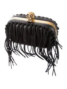ALEXANDER MCQUEEN FRINGE SKULL BOX CLUTCH  NOW $563.50 - 30% OFF  PRODUCT DETAILS  Black leather Alexander McQueen Skull Box clutch with gold-tone hardware, fringe trim, tonal leather lining and push-lock closure at top featuring signature ornate skull embellishment.