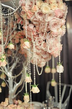 I love the use of depth of field in this photo. its gorgeous. also loving the pearls and hanging roses! beautiful!