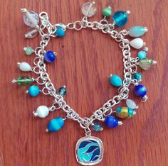 Check out this item in my Etsy shop https://www.etsy.com/listing/240789736/ocean-inspired-charm-bracelet