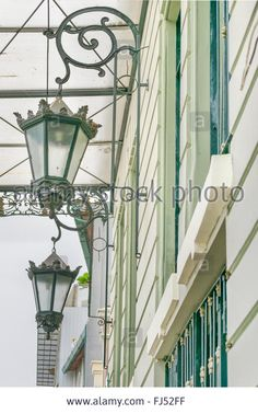 Download this stock image: Low angle view of antique decorated iron city lamps at historic center Las Penas in Guayaqui, Ecuador - FJ52FF from Alamy's library of millions of high resolution stock photos, illustrations and vectors.