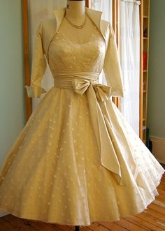 50's inspired polka dot tea length wedding dress  £1800