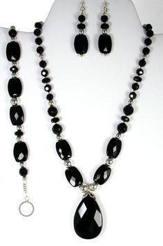 A black earring, necklace, and bracelet set for a formal Cinderella ball gown look.