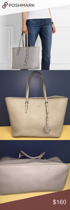 Micheal Kors Jet Set textured Tote This tote is very gently used. Has a few pen marks inside possibly easily cleaned. Has tiny dot in the bottom of price. Bag is in great condition. Price firm. No trades Michael Kors Bags Totes