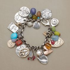 COLLECTOR'S ITEM BRACELET--Big, bold, jangly and joyous, this limited-edition Sundance exclusive is Jes MaHarry at her bountiful best. Sterling silver and 18kt gold charms etched with meaning