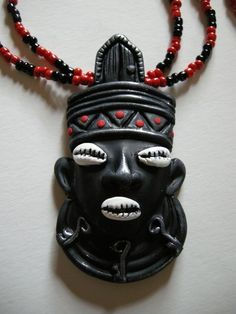 Elegua Necklace by olgaayala on Etsy, $25.00