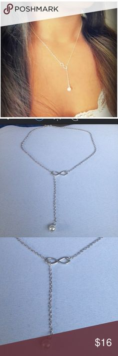 NWOT silver Infinity Necklace NWOT silver infinity necklace with a pearl. Jewelry Necklaces