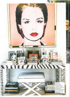 Andy Warhol Carolina Herrera portrait over a glam zebra console & x-stool