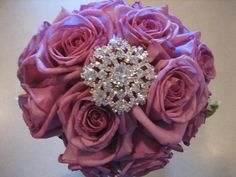 love showering bridesmaids with jewels in their bouquet