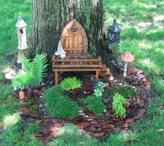 from Garden-Share - It is challenging to create a miniature garden that appears to fit in the great outdoors.  This miniature garden appears to fit in perfectly!