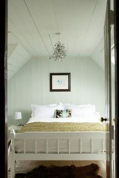 Wood paneling.  Painted white is lovely.  Great guest room idea.