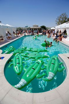 Coachella Party Pics  http://www.refinery29.com/2014/04/66306/coachella-party-pictures#slide1  Is it just us, or are the inflatable alligators having as much fun as the guests at the Lacoste Beautiful Desert Pool Party?
