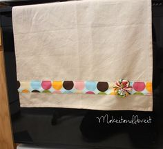 Dress Up that Tea Towel | Make It and Love It.  I am going to do this to cheap plain tea towels to add the lavender I have been wanting in my kitchen.