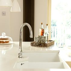 Kitchens: Bright Kitchen with White Worktop also Double Bowl Sink plus Chrome Finished Sink Faucet and White Pendant Lights Grey Painted Kitchen, Kitchen Paint, Kitchen Design, Stove Range Hood, Corn In The Microwave, Double Bowl Sink, White Pendant Light, Stainless Steel Oven, Range Cooker
