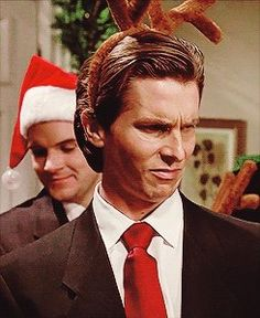 """Merry Xmas Patrick!"" Patrick Bateman looks with disgust at his 'supposed fiancé's' pet pig.  Christian Bale in American Psycho"