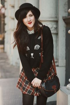 More cat sweaters. This is a great twist on preppy school uniforms paired with a classic purse. Click through to check out the buckle shoes (and socks!)