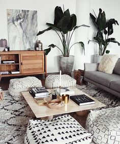 Bohemian Style Living Room Space with Ottoman Seating and Indoor Botanicals