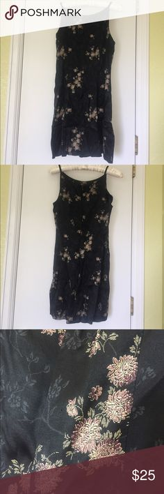 🌟New listing! 🌟 Black dress with Floral print This black dress with floral print will be a cute new addition to your closet! Very comfortable and flattering! Very classy design! Has a fun crinkly look! Has been gently loved but is in great condition! From a smokefree home! Dry clean only! all that jazz Dresses