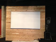 reclaimed wood wall in youth ministry room w/DIY video screen done with flat paint on the wall.