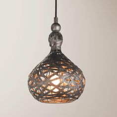 """Aged Tin Wrapped Onion Pendant This modern pendant is handcrafted and sculptural with mixed metallic straps in mottled gun metal and bronze tones over an interior onion shaped cage for rustic industrial flair. 1-60watt max. 15' black cloth covered cord with 5.5"""" round metal canopy included. (13""""H x 9""""W)"""