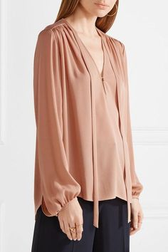 Blush silk  Hook-fastening keyhole at front 100% silk  Dry clean Designer color: Pale Rose