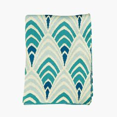 This looks like the color scheme at Bar Sajor - but I like the blue combination and the fabric.  Swell Deco Throw - Aqua | dotandbo.com