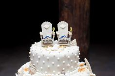 A beach wedding cake with a bliss of toast at the sea.