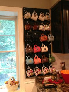 Mug Display made from peg board that can be purchased at Home Depot... Decorative and a great cabinet space saver!
