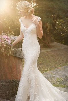 Essense of Australia. See more details from Essense of Australia��Fit-and-flare bridal gown features an illusion tattoo lace design, scalloped hem and a gorgeous train. The back zips up under fabric buttons.