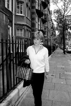 Lady Diana, avoiding making eye contact with the photographers.