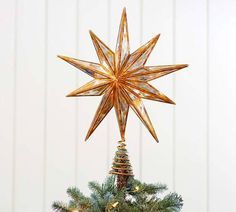 Cap off your holiday decor in style with these unique ideas for Christmas tree toppers. We included cool, creative takes on angel Christmas tree toppers and Christmas tree star toppers too.