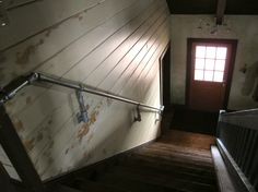When we were trying to get our final inspection, we failed because the wood handrail was wider than To solve the problem we hung a galvanized pipe on the adjacent wall using these slip-fi… Pipe Railing, Outdoor Stair Railing, Wood Handrail, Hand Railing, Railings, Industrial Door, Industrial Bedroom, Industrial Design, Cottage Stairs