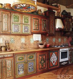 Cabin Fever~ kitchen cabinetry is painted with folk-art designs~ ~ELLE DECOR Kitchen Art, Kitchen Dining, Kitchen Decor, Kitchen Cabinets, Gypsy Kitchen, 1970s Kitchen, Eclectic Kitchen, Cozy Kitchen, Rustic Kitchen
