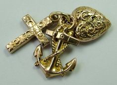 A Victorian c1900 9ct gold puffed (hollow) Faith, Hope and Charity set which includes a cross, anchor and heart.