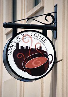 Coffee shop sign. Love how the bracket mimics the swirls of the coffee! Coffee logo. Designed by adunate.com