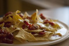 It's late but we could certainly eat some nachos now. Could you? #nachos #baked #salsa #snack