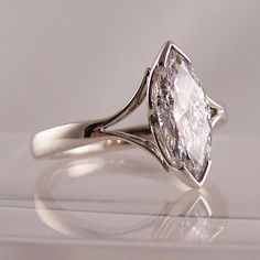 Marquise cut #diamond set in #platinum with split shoulder detail. From @RING jewellers #brighton